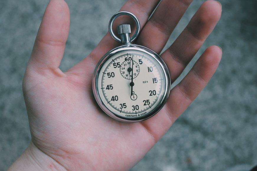 holding stopwatch in hands