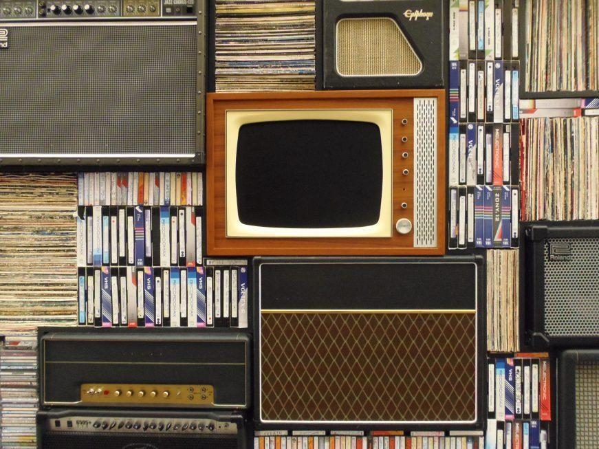 old television set among books